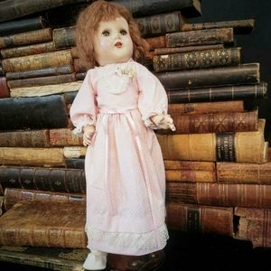 Vintage Horsman doll with a pretty pink dress.